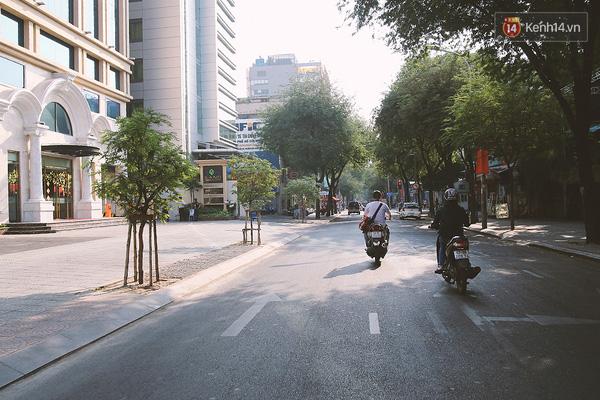 Một Sài Gòn không ồn ã rất khác lạ trong ngày đầu năm mới - Ảnh 1.