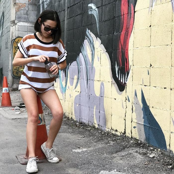 Phong cách giấu quần cũng được các cô gái khá ưa chuộng đấy.