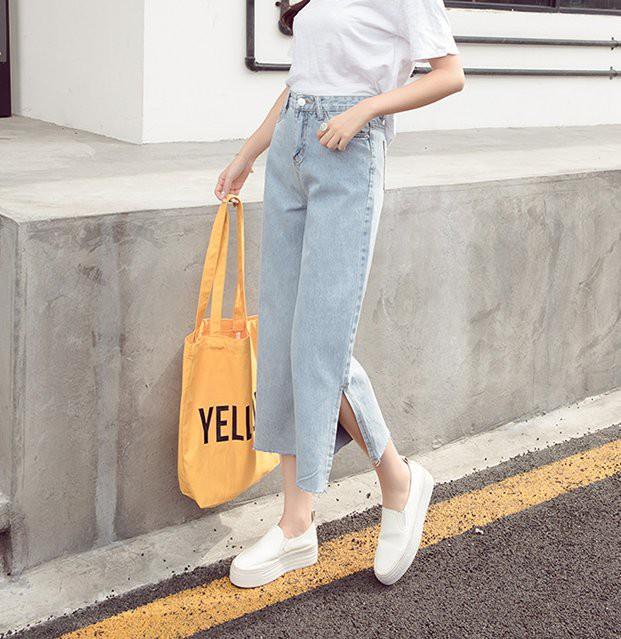Quần jeans ống xẻ bên không phải là bị lỗi đâu mà chính là hot trend năm nay đấy! - Ảnh 5.