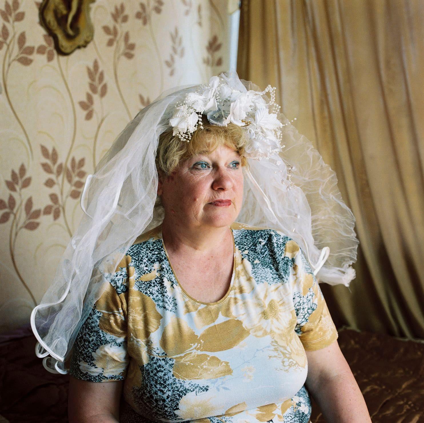 Lý do gì khiến phụ nữ ở Belarus luôn giữ gìn váy cưới cẩn thận suốt hàng chục năm? - Ảnh 2.