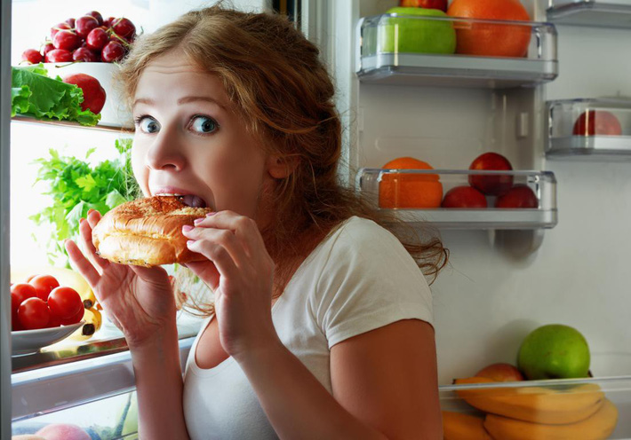 a-woman-snacking-from-the-fridge