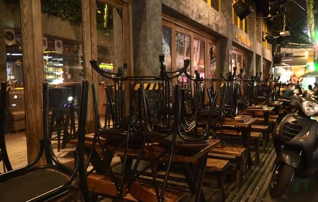 Ảnh: Các quán bar, karaoke ở trung tâm Sài Gòn đóng cửa để phòng dịch - Ảnh 10.