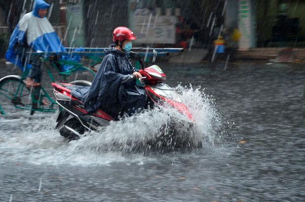 Bão số 2 đã suy yếu thành áp thấp nhiệt đới, miền Bắc tiếp tục mưa lớn trong nhiều ngày - Ảnh 1.